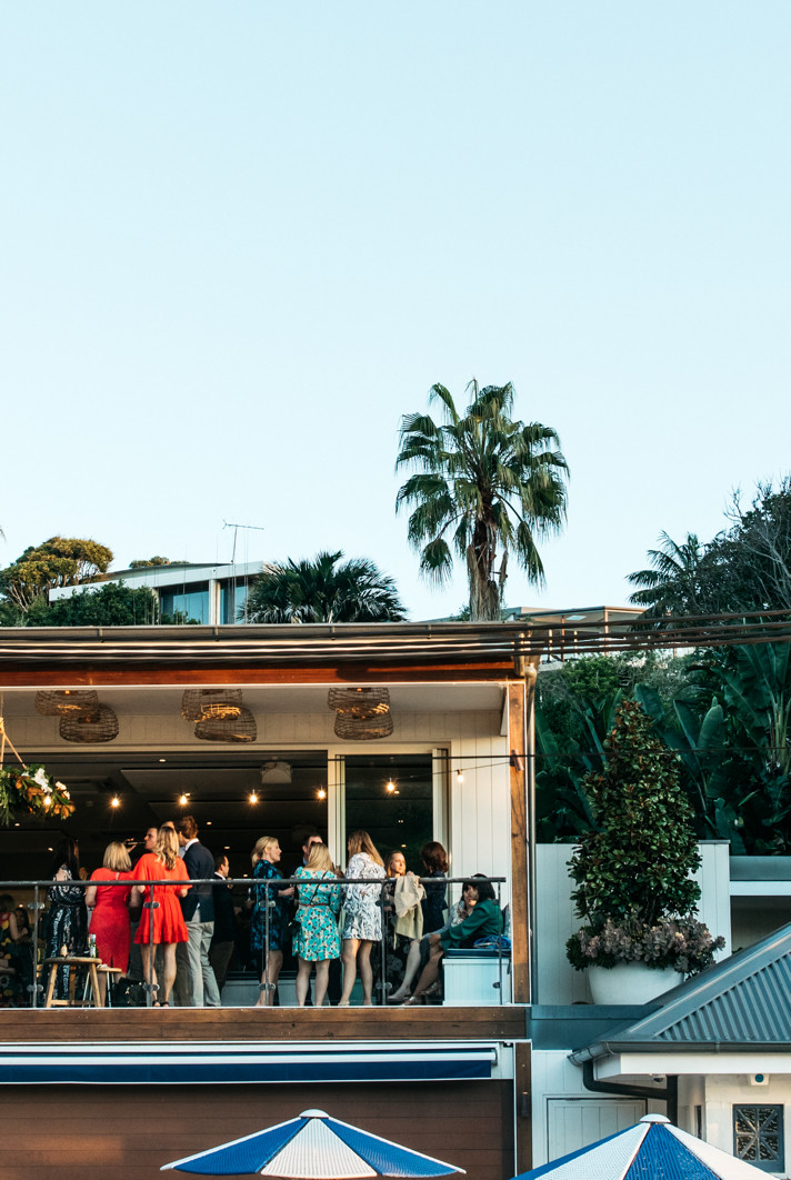 Wedding guests mingle on the Boathouse balcony.
