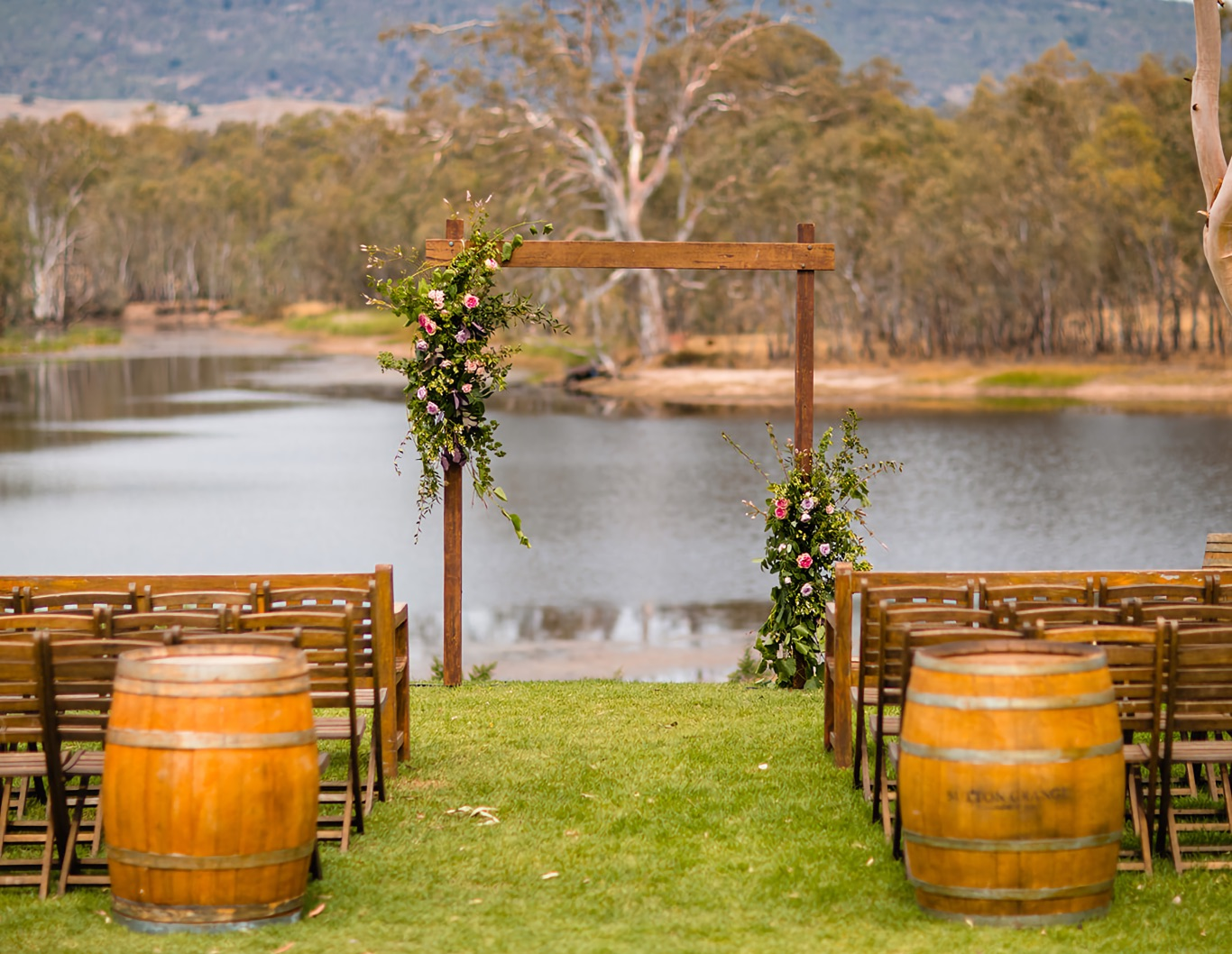 Wedding asile and archway overlooking water.