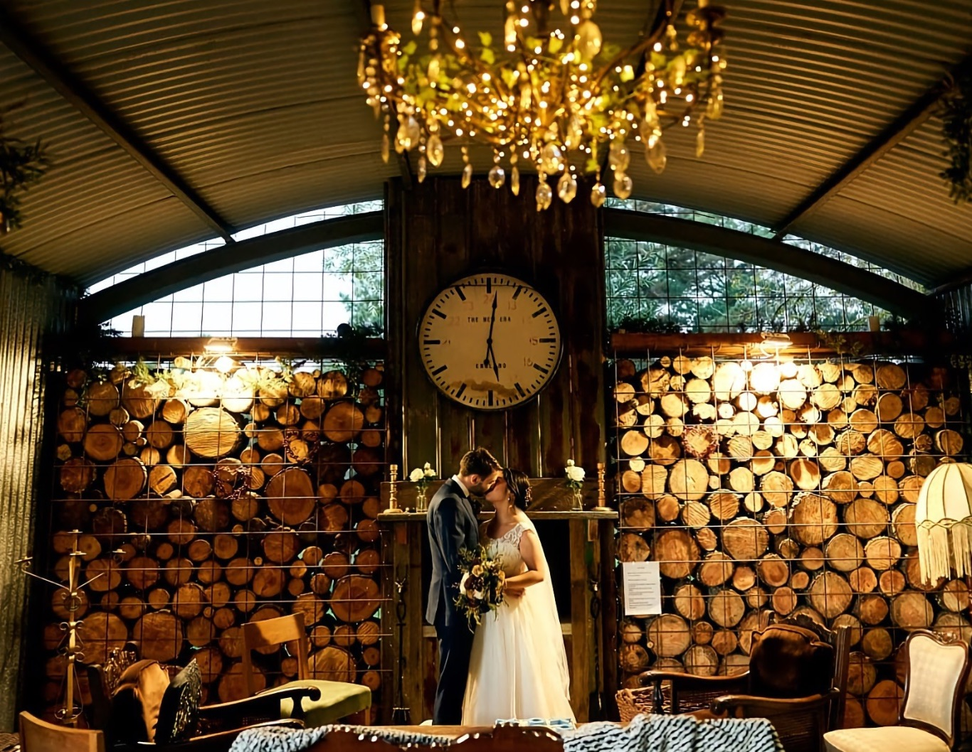 Wedding couple embrace in a country cabin.